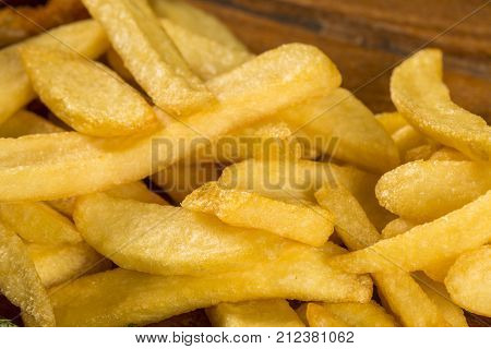 Fries portion close up. Portion on the wood background