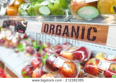Organic Food Signage On Modern Supermarket Fresh Produce Fruits Aisle