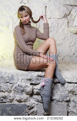 sexy girl sitting on wall