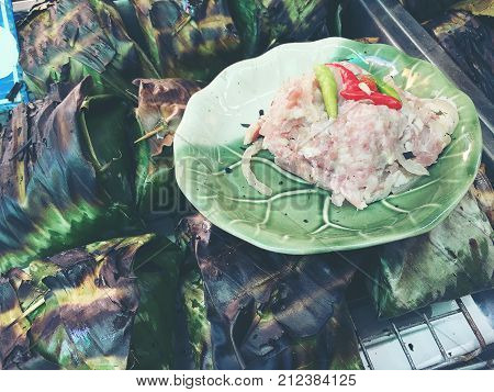 Pork Shredded On Grill Banana Leaf At Local Market : Pork, Shredded And Salted, Bound Tightly With B