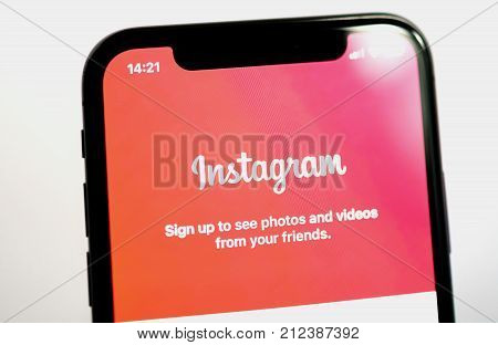 PARIS FRANCE - NOV 5 2017: Instagram Photo social network community log-in screen on the new Apple iPhone X 10 smartphone made by Apple Computers