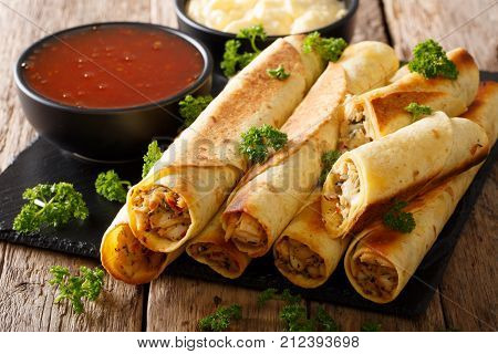 Tasty Taquitos With Chicken And Two Sauces Close-up. Horizontal