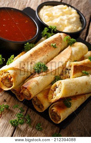 Taquitos With Chicken And Cheese Close-up, As Well As Sauces. Vertical