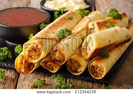 Baked Taquitos With Chicken And Cheese Close-up. Horizontal