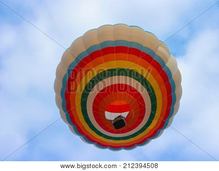 Hot air balloon in the sky. View from below.