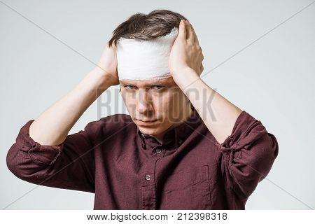 Man With Bandage On His Head