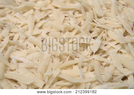 Backgroung made of white pieces of grated cheese
