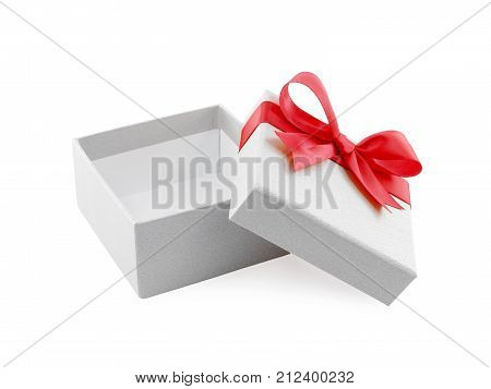 close-up open and empty white gift box with red ribbon bow wrapped around the lid isolated on white background