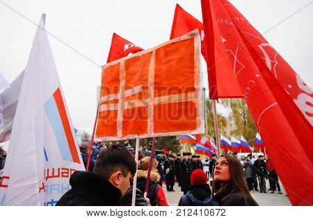 Orel, Russia, November 4, 2017: Unity Day  Demonstration. Young Men With Red Communist Flags And Bla
