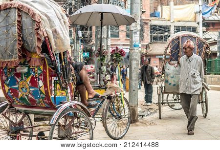 KATHMANDU - OCTOBER 05: Trishaws have a rest at Durbar Square in Kathmandu, Nepal, October 05, 2017