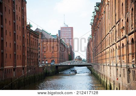 Waterfront area in Hamburg, Germany. Speicherstadt (City of Warehouses - warehouse district). Boat on water