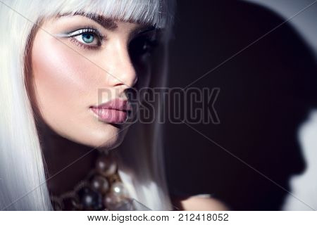 High fashion model girl portrait. Beauty woman with white hair and beautiful make-up. Winter style. Haircut. Hairstyle. Fringe. Beautiful Model with Short Blond hair. Bob hair cut. Fashion Blonde Girl