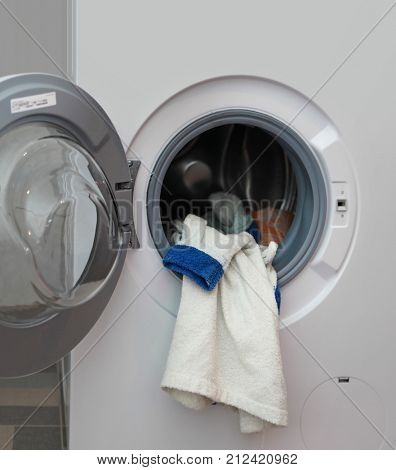 white dressing gown in the washing machine