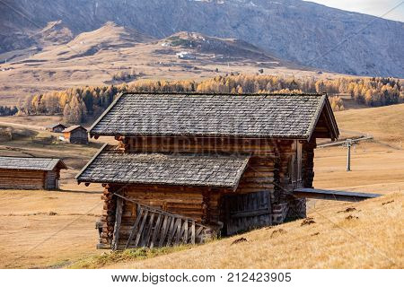 Wooden Cottages in the Dolomites. Typical wooden cottage in meadows in Domomite. Old wooden house in mountain. Dolomites Italy