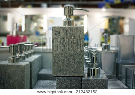 Soap dish dispenser for liquid soap on store shelves background. hygiene facilities.