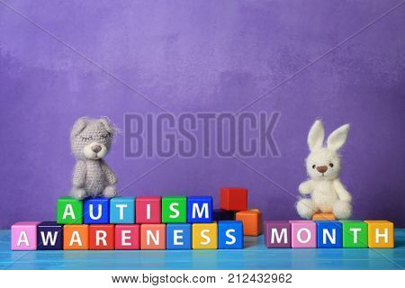 Cubes with text AUTISM SPECTRUM MONTH on table