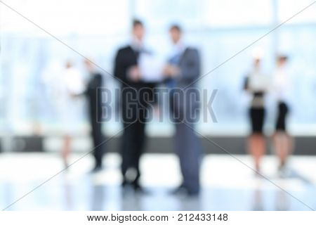 business background.blurred image of business people standing in office.