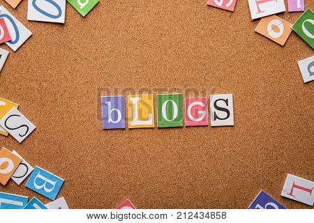 Word BLOGS on brown background