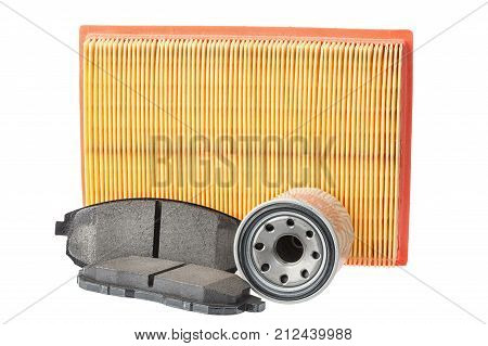Set of brake pads oil filter air filter. Car spares isolated on white background.