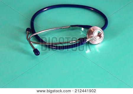 Stethoscope with reflection. stethoscope background. stethoscope with reflection on glossy background.