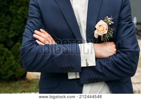 rose pinned to the lapel of the groom