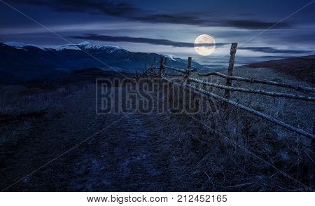 Wooden Fence In Mountainous Countryside At Night