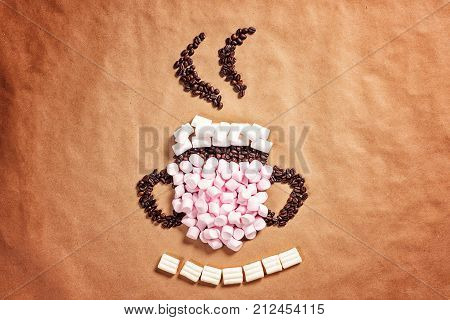 Mug Cup Of Hot Coffee Cocoa From Pink Marshmallows And Grain Coffee On Old Paper Background