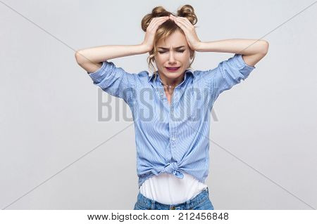 Bad emotions and feelings concept. Headache. Blonde woman touching head and have a migraine. Studio shot poster