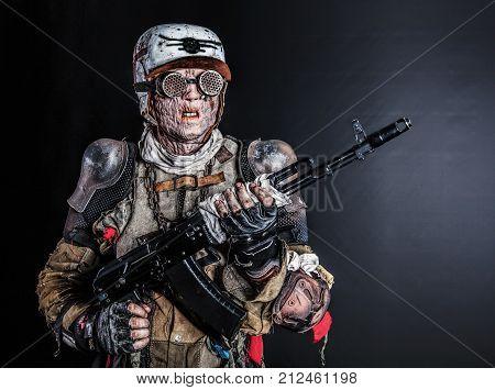 Post apocalyptic survivor creature with homemade weapons