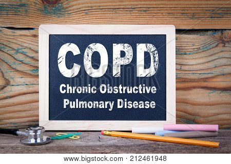 copd, Chronic obstructive pulmonary disease. Chalkboard on a wooden background.