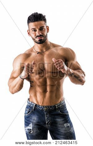 Attractive muscleman pointing thumb finger at himself, confident expression