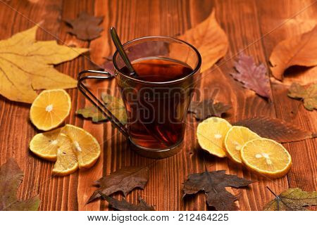 Hot Beverage In Glass On Wooden Background.