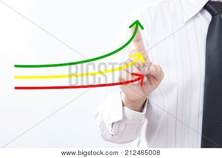 Benchmarking and market leader concept. Manager (businessman coach leadership) touch graph with three lines one of them represent the best company in competition.