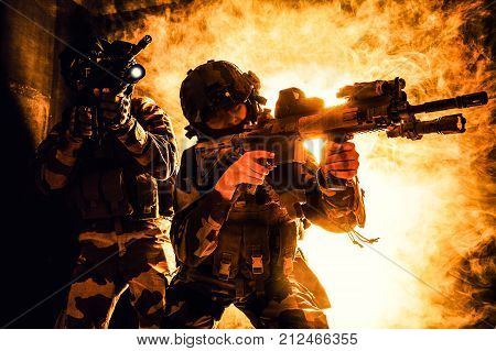 Paratroopers of french 1st Marine Infantry Parachute Regiment RPIMA studio shot firing pointing weapons