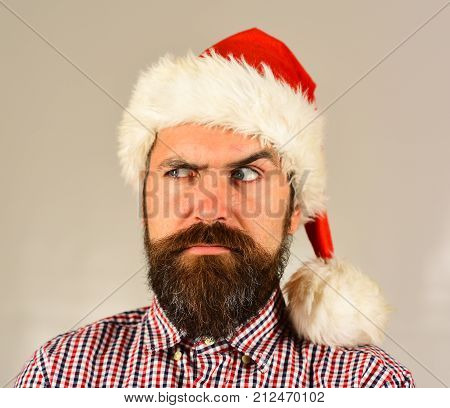 Man With Suspicious Face On Grey Background