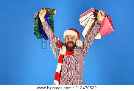 Santa With Colorful Packets. Man With Beard And Winner Face