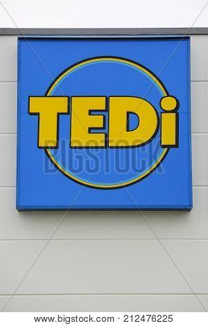 LINDEN GERMANY JULY 2017: TEDI supermarket chain sign. TEDI is a German global discount supermarket chain based in Dortmund Nordrhein-Westfalen Germany.