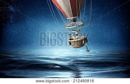 Businessman travel on air balloon
