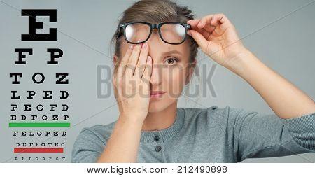 Woman In Glasses. Eye Test. Eyesight Vision Exam Chart