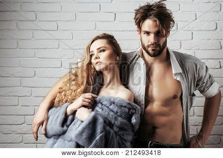 Couple In Love On White Brick Wall