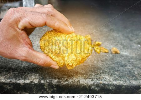 Big pure gold ore found in the mine on hand. A lump of gold.