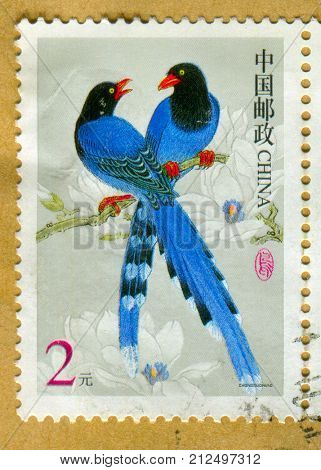 GOMEL, BELARUS, 27 OCTOBER 2017, Stamp printed in China shows image of The Taiwan blue magpie (Urocissa caerulea), Formosan blue magpie, or the