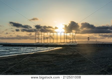 Sunset On The Sea Through The Clouds In Piombino, Tuscany, Italy