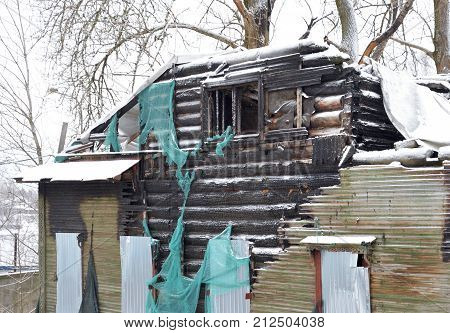 Burnt building at winter the village of Ust-Slav outskirts of St. Petersburg Russia.