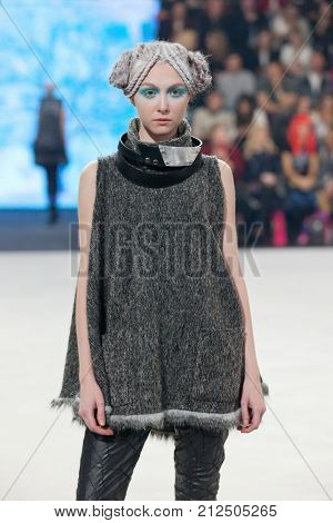 ZAGREB, CROATIA - OCTOBER 28, 2017: Fashion model wearing clothes from the Fall/Winter collection designed by Marina Design and necklace designed by Marija Ivankovic at the 'Fashion.hr' fashion show