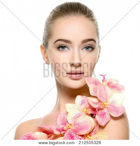 Beautiful young woman with flower in hand near at face.  Closeup portrait of caucasian girl with healthy clean skin. Skin care. beauty treatment  - isolated on white background