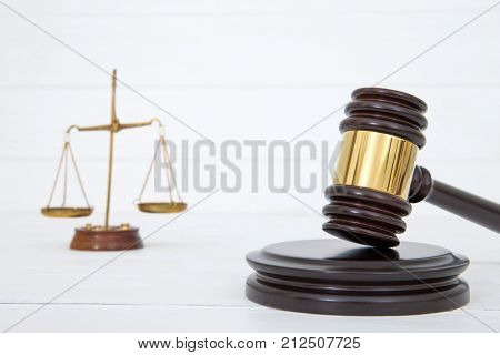 Judges gavel and sound block on wooden background