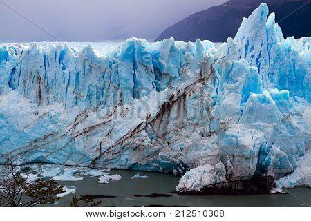 Patagonia. Fantastic lake and glacier Perito Moreno. On the surface of the glacier formed Calgaspors -