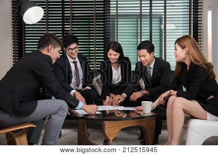 young business professionals having a meeting in officeWorkers discussing new business plan together in a conference room.