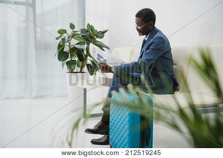 Middle Aged Businessman Reading Newspaper